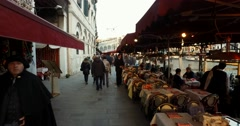 Steady cam passing crowded restaurants and canal Grande in Venice Italy 4k - stock footage