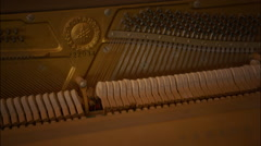 Inside vintage retro piano's hammers striking strings - stock footage