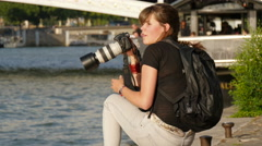 Woman taking pictures by Seine River, Paris Stock Footage