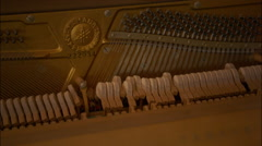 Hammers strings inside vintage retro piano mechanics - stock footage