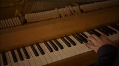 Piano player hands seen from above - stock footage