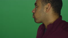 African American man making funny faces, on a green screen background Stock Footage