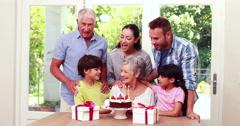 Happy family celebrating birthday - stock footage