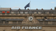 Waving flag on top of the Air France Building in Paris Stock Footage