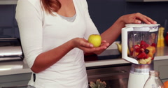 Happy woman making smoothie Stock Footage