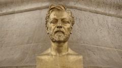 Gustave Eiffel golden statue in Paris Stock Footage