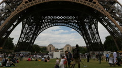 Tilt up view of the Eiffel Tower on a cloudy day in Paris Stock Footage