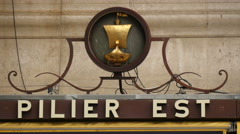 The East Pillar (Pilier Est) sign at Eiffel Tower in Paris Stock Footage