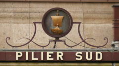 The South Pillar (Pilier Sud) sign at Eiffel Tower in Paris Stock Footage