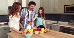 Happy family making smoothie Stock Footage