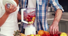 Happy couple making smoothie Stock Footage