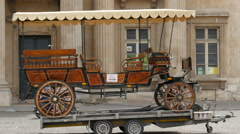 A horse carriage on a mobile platform tow in Paris Stock Footage