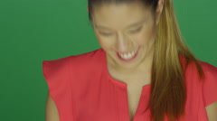 Beautiful young lady laughing, on a green screen background Stock Footage
