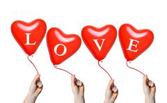 Hand holding a red heart balloons Stock Photos