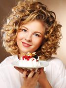 beautiful smiling young woman with a cake - stock photo