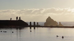 The Sutro Baths and the ocean at sunset in San Francisco, California. Stock Footage