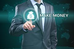 Business, technology, internet concept - businessman pressing make money button Stock Photos