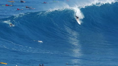 Professional surfer rides a giant wave at the le Stock Footage