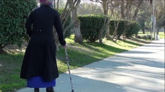 Mysterious Old Lady Walking With Cane Stock Footage