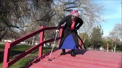 Disabled Women Having Difficulty Walking On Wood Bridge - stock footage
