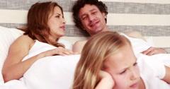 Stock Video Footage of Siblings talking on bed