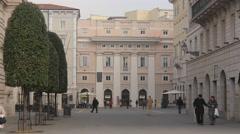 People walking in Piazza Giuseppe Verdi in  Trieste Stock Footage