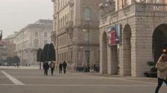 People walking in Piazza Giuseppe Verdi near Teatro Verdi in  Trieste Stock Footage