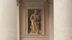 Sculpture of a man on Palazzo della Borsa Vecchia in Trieste Stock Footage