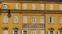 Amazing view of a beautiful yellow building and a lamp post in Trieste Stock Footage