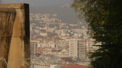 The cityscape and a fountain seen from Parco della Rimembranza in Trieste Stock Footage