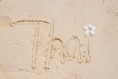 Thai Lettering on Sand - stock photo