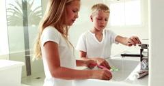 Stock Video Footage of Siblings washing teeth together