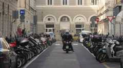 Motor scooters and cars on Via di Torre Bianca in Trieste Stock Footage