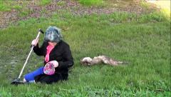Old Blind Women Sitting At Bottom Of Ditch Putting Hat Back On Head Stock Footage