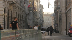 People and a dog walking on Via Trento and Ponte Curto in Trieste Stock Footage
