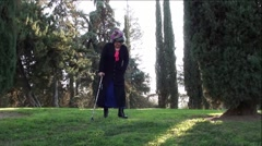 Old Victorian Woman With Cane Lost In Park Stock Footage