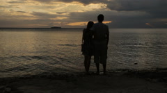 sunset silhouette of couple on the beach - stock footage