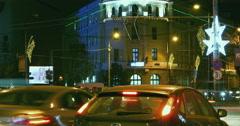 BUCHAREST - ROMANIA, December 2015, Night traffic  with car pass, Christmas Stock Footage