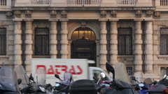 Parked motor scooters  in front of Palazzo delle Assigurazioni Generali, Trieste Stock Footage