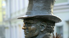 A statue of a chimney sweeper in the streets Stock Footage