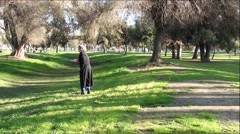 Old Handicapped Woman Walking In Park Falls Down On Ground Stock Footage