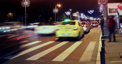 BUCHAREST - ROMANIA, December 2015, Night traffic  with car pass, zebra Stock Footage