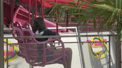 Children waiting in a air swing carrousel in Paris - stock footage