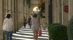 People walking on a corridor near Angelina Tea House, on Rue de Rivoli, Paris - stock footage