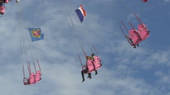 Stock Video Footage of View of a pink air swing carrousel spinning in Paris