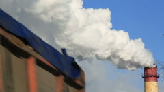 Freight transport on background of industrial smoke from the pipes against blue Stock Footage