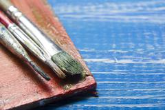 Painting tools colour palette and Artist paint brushes on abstract artistic Stock Photos