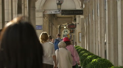 People passing by shops on a corridor of a building on Rue de Rivoli, Paris Stock Footage