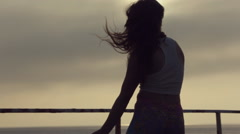 Talented and full of the positive teenager girl dancing on the pier by the sea Stock Footage