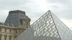 The Louvre Pyramid and the Louvre Museum, on a cloudy day in Paris Stock Footage
